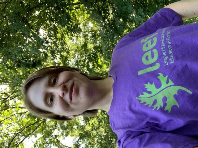 Jackie Zimmerman is looking great in purple as she shows off her LEEF t-shirt